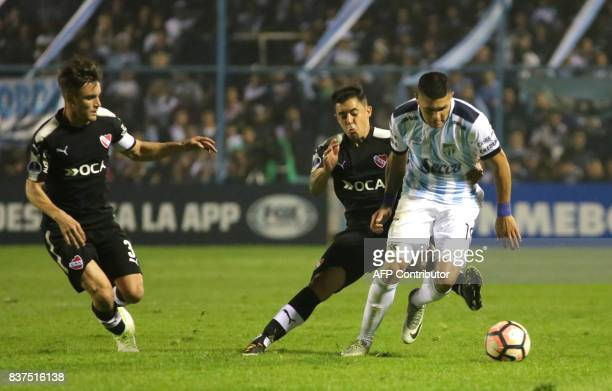 David Barbona of Atletico Tucuman vies for the ball with Diego Rodriguez of Independiente during their Copa Sudamericana 2017 football match at the...