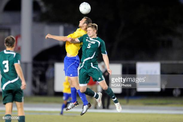 David Barden of Fort Lewis College and Dale Parker of LeesMcRae battle for the ball during the Division II Men's Soccer Championship held at Pepin...