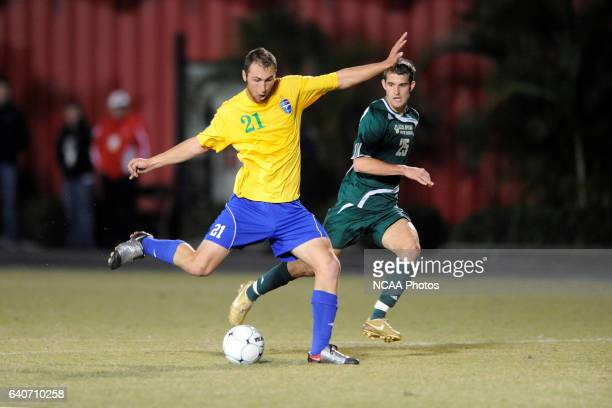 David Barden of Fort Lewis kicks the ball down field during the Division II Men's Soccer Championship held at Pepin Stadium on the Tampa University...