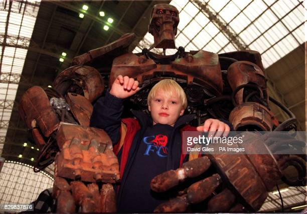 David Barker of Croydon south London with the ABC robot from the film Judge Dread at the International Model Show in London's Olympia this morning...