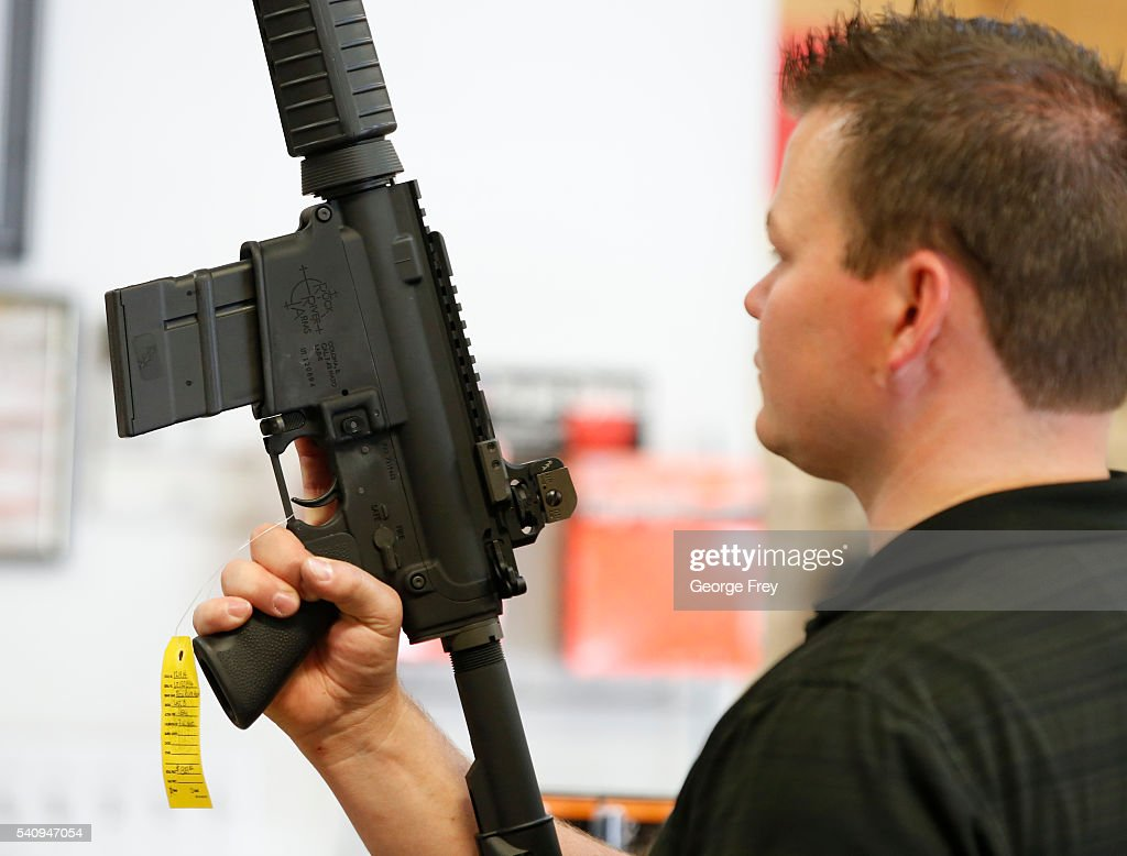 David Barkerlooks at an AR15 semiautomatic gun to at Action Target on June 17 2016 in Springville Utah Semiautomatics are in the news again after the...