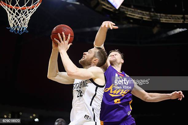 David Barlow of United lays up a shot under pressure from Brad Newley of the Kings during the round 10 NBL match between the Sydney Kings and...