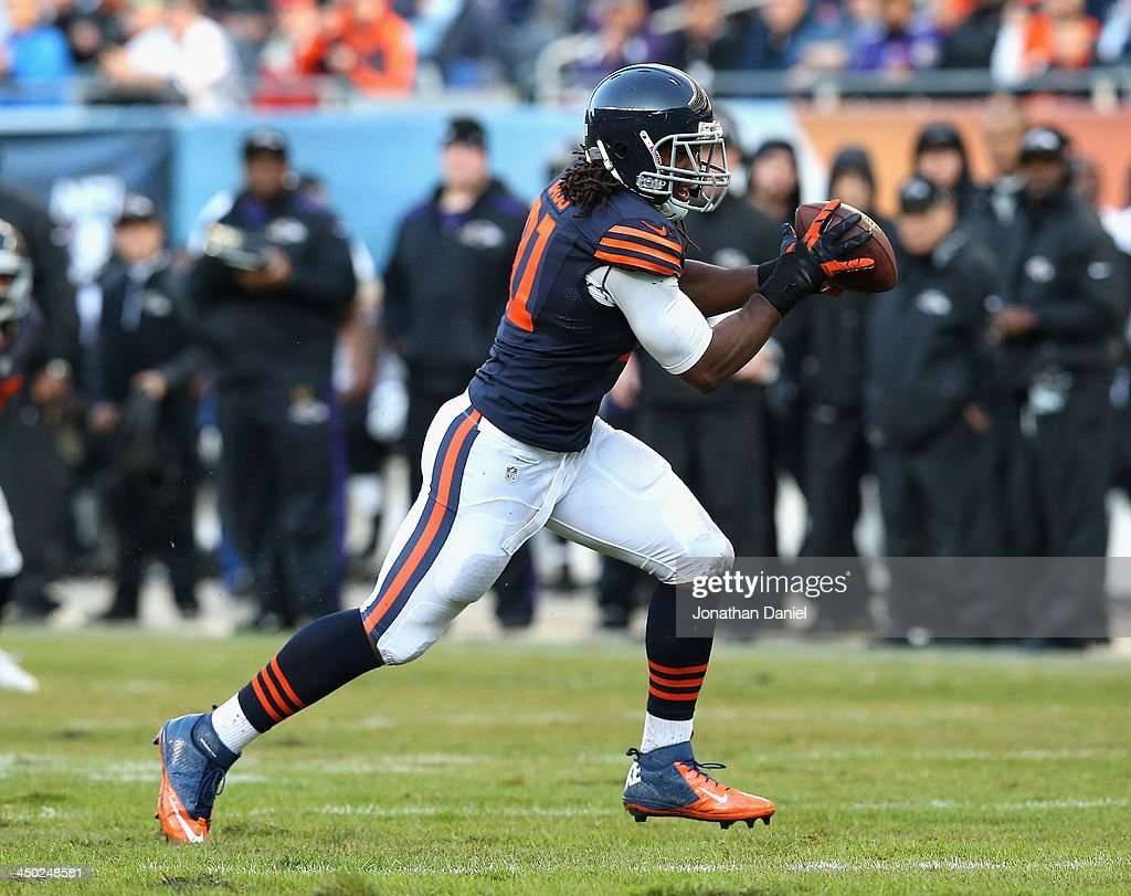 David Bass #91 of the Chicago Bears intercepts a pass for a touchdown against the Baltimore Ravens at Soldier Field on November 17, 2013 in Chicago, Illinois.