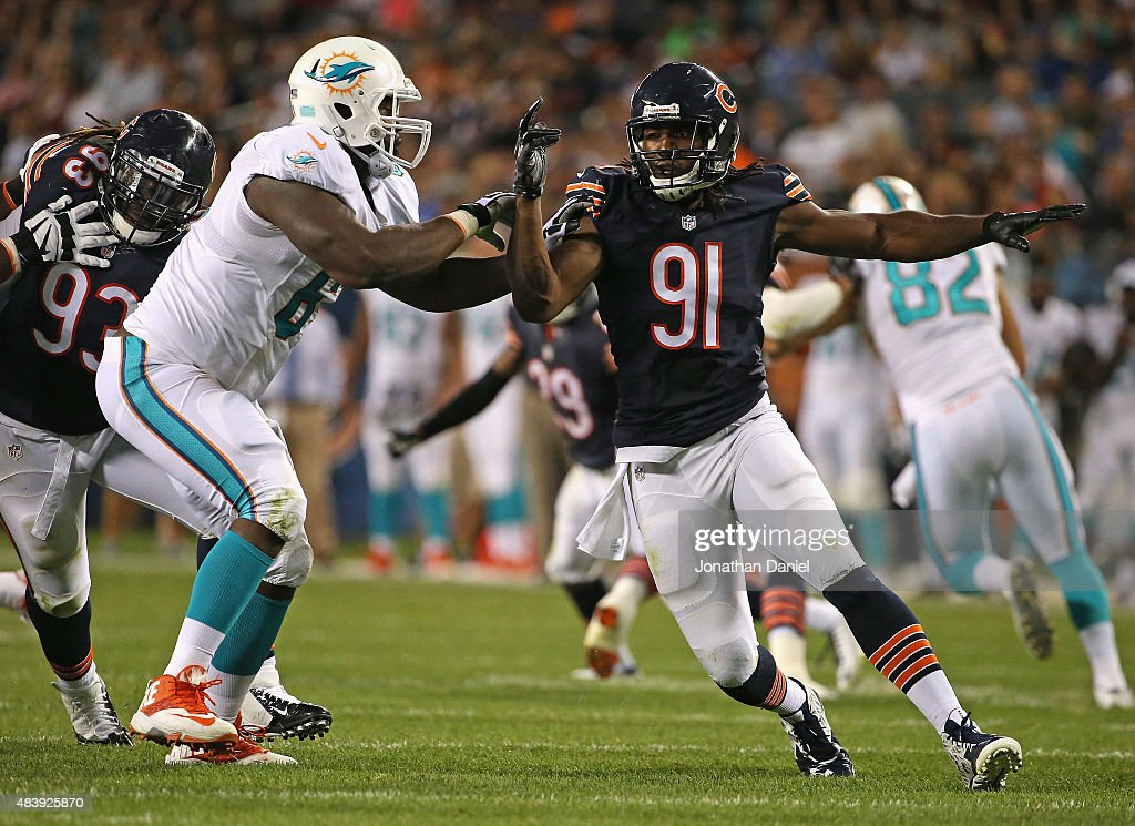 David Bass #91 of the Chicago Bears rushes against Donald Hawkins #61 of the Miami Dolphins during a preseason game at Soldier Field on August 13, 2015 in Chicago, Illinois. The Bears defeated the Dolphins 27-10.