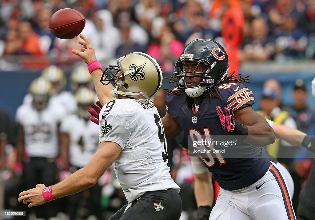 David Bass #91 of the Chicago Bears rushes to <a gi-track='captionPersonalityLinkClicked' href=/galleries/search?phrase=Drew+Brees&family=editorial&specificpeople=202562 ng-click='$event.stopPropagation()'>Drew Brees</a> #9 of the New Orleans Saints at Soldier Field on October 6, 2013 in Chicago, Illinois. The Saints defeated the Bears 26-18.