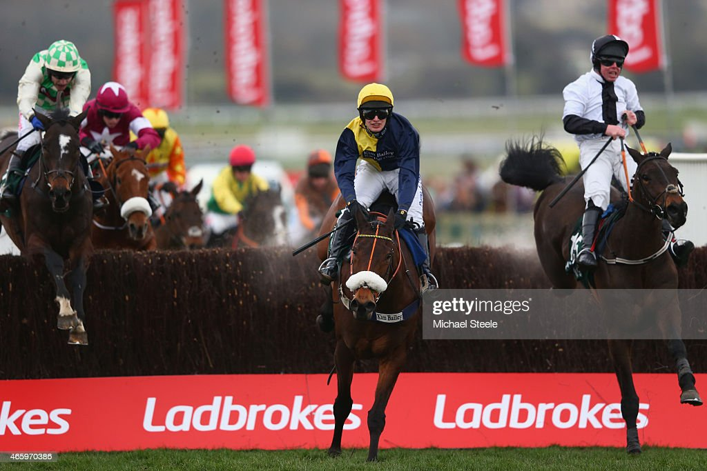 David Bass riding Darna on his way to victory in the Brown Advisory and Merriebelle Steeplechase clears the last from Andrew Lynch riding Rawnaq and...