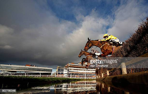 David Bass riding Silvergrove clear the water jump on their way to winning The Betfred Mandarin Handicap Steeple Chase at Newbury racecourse on...