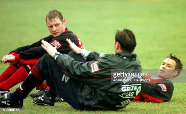 David Batty and Graeme Le Saux listen to manager Glenn Hoddle during England football training at Bisham Abbey near Marlow this afternoon England...