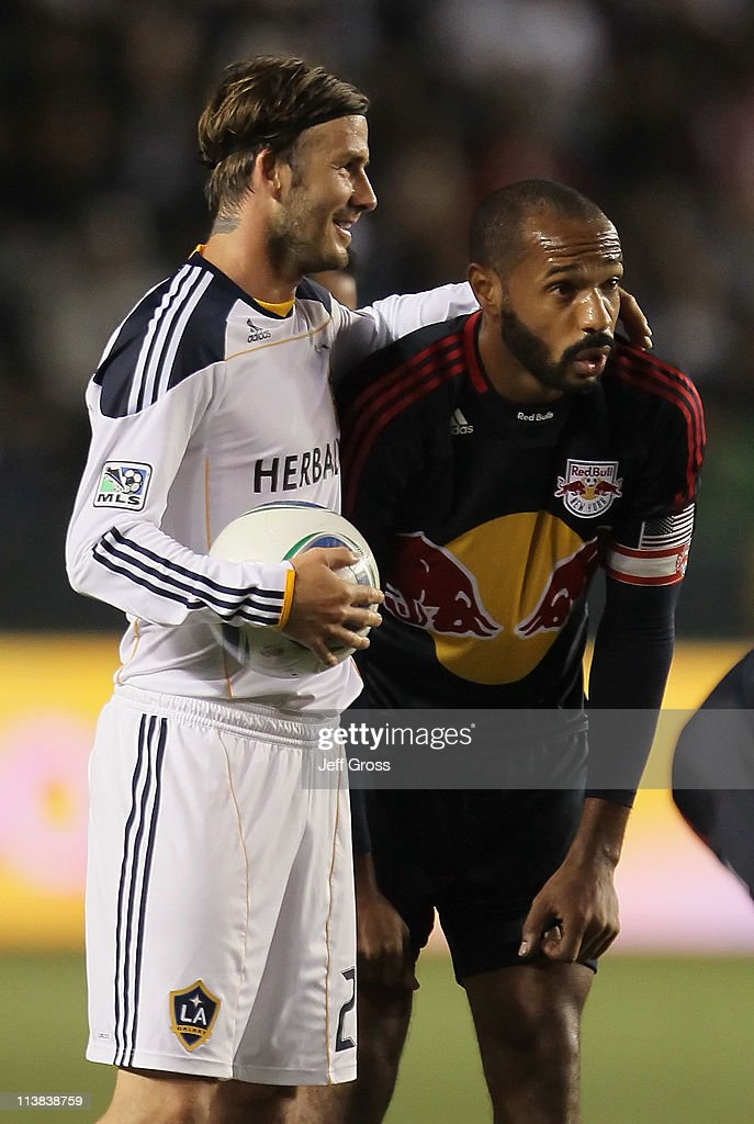 <a gi-track='captionPersonalityLinkClicked' href=/galleries/search?phrase=David+Beckham&family=editorial&specificpeople=158480 ng-click='$event.stopPropagation()'>David Beckham</a> (L) #23 of the Los Angeles Galaxy puts his arm around <a gi-track='captionPersonalityLinkClicked' href=/galleries/search?phrase=Thierry+Henry&family=editorial&specificpeople=167275 ng-click='$event.stopPropagation()'>Thierry Henry</a> #14 of the New York Red Bulls in the second half at The Home Depot Center on May 7, 2011 in Carson, California. The Red Bulls and Galaxy played to a 1-1 draw.