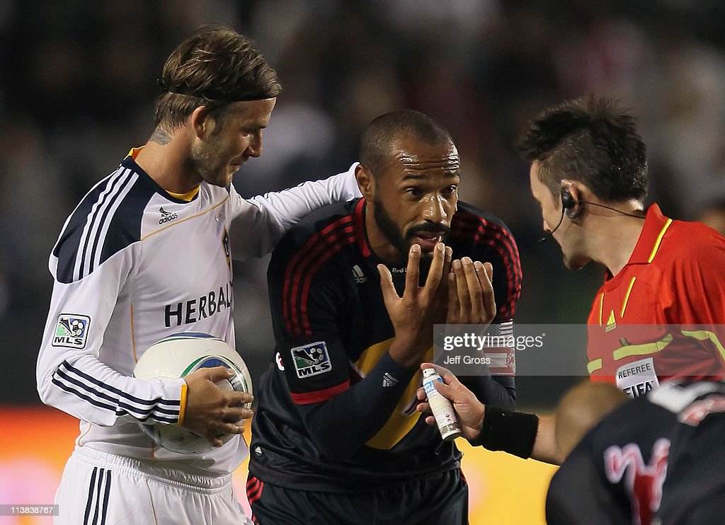 <a gi-track='captionPersonalityLinkClicked' href=/galleries/search?phrase=David+Beckham&family=editorial&specificpeople=158480 ng-click='$event.stopPropagation()'>David Beckham</a> (L) #23 of the Los Angeles Galaxy puts his arm around <a gi-track='captionPersonalityLinkClicked' href=/galleries/search?phrase=Thierry+Henry&family=editorial&specificpeople=167275 ng-click='$event.stopPropagation()'>Thierry Henry</a> #14 of the New York Red Bulls, as Henry pleads his case to referee Edvin Jurisevic in the second half at The Home Depot Center on May 7, 2011 in Carson, California. The Red Bulls and Galaxy played to a 1-1 draw.
