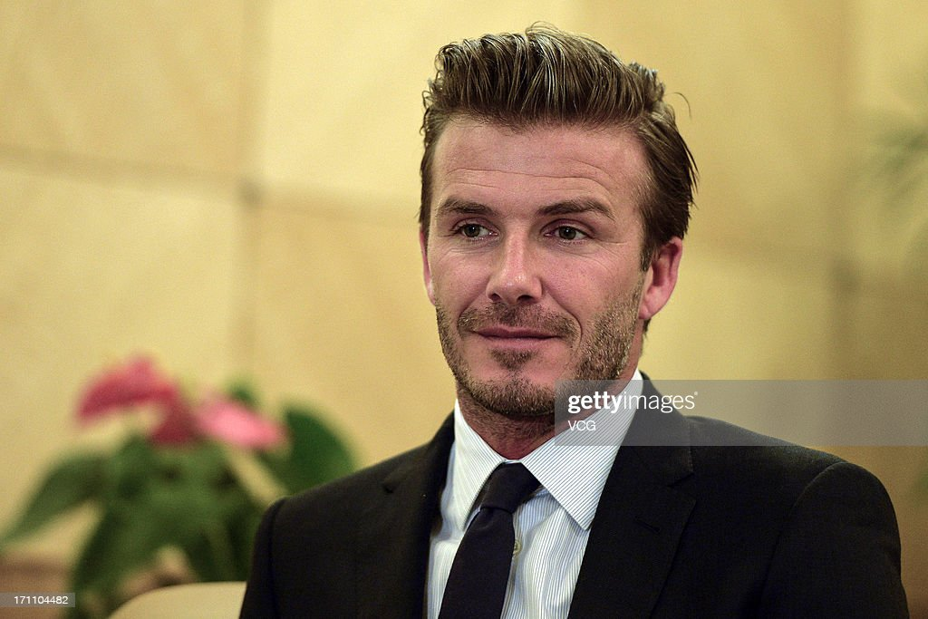 David Beckham accepts the CCTV interview during the Chinese Super League match between Hangzhou Greentown and Beijing Guoan at Yellow Dragon Sports Center on June 22, 2013 in Hangzhou, China.