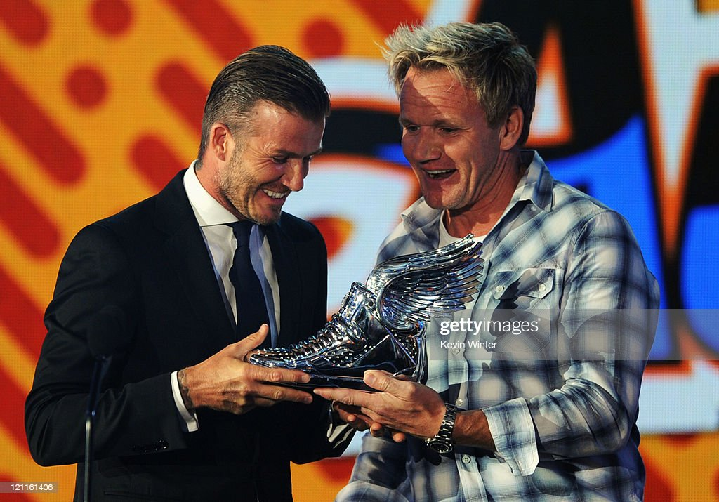 David Beckham accepts the Do Something Athlete award from Gordon Ramsey onstage during the 2011 VH1 Do Something Awards at the Hollywood Palladium on...