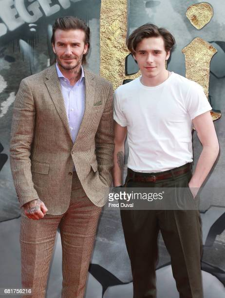 David Beckham and Brooklyn Beckham attend the European premiere of 'King Arthur Legend of the Sword' at Cineworld Empire on May 10 2017 in London...