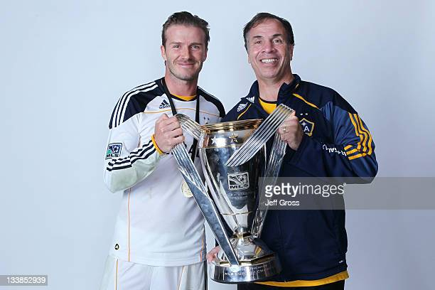 David Beckham and Bruce Arena of the Los Angeles Galaxy pose for a portrait following the 2011 MLS Cup at The Home Depot Center on November 20 2011...