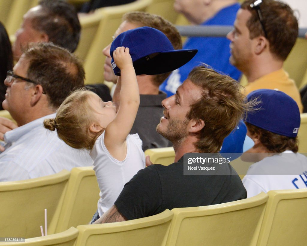 <a gi-track='captionPersonalityLinkClicked' href=/galleries/search?phrase=David+Beckham&family=editorial&specificpeople=158480 ng-click='$event.stopPropagation()'>David Beckham</a> (R) and daughter <a gi-track='captionPersonalityLinkClicked' href=/galleries/search?phrase=Harper+Beckham&family=editorial&specificpeople=8262359 ng-click='$event.stopPropagation()'>Harper Beckham</a> attend a baseball game between the Chicago Cubs and the Los Angeles Dodgers at Dodger Stadium on August 27, 2013 in Los Angeles, California.