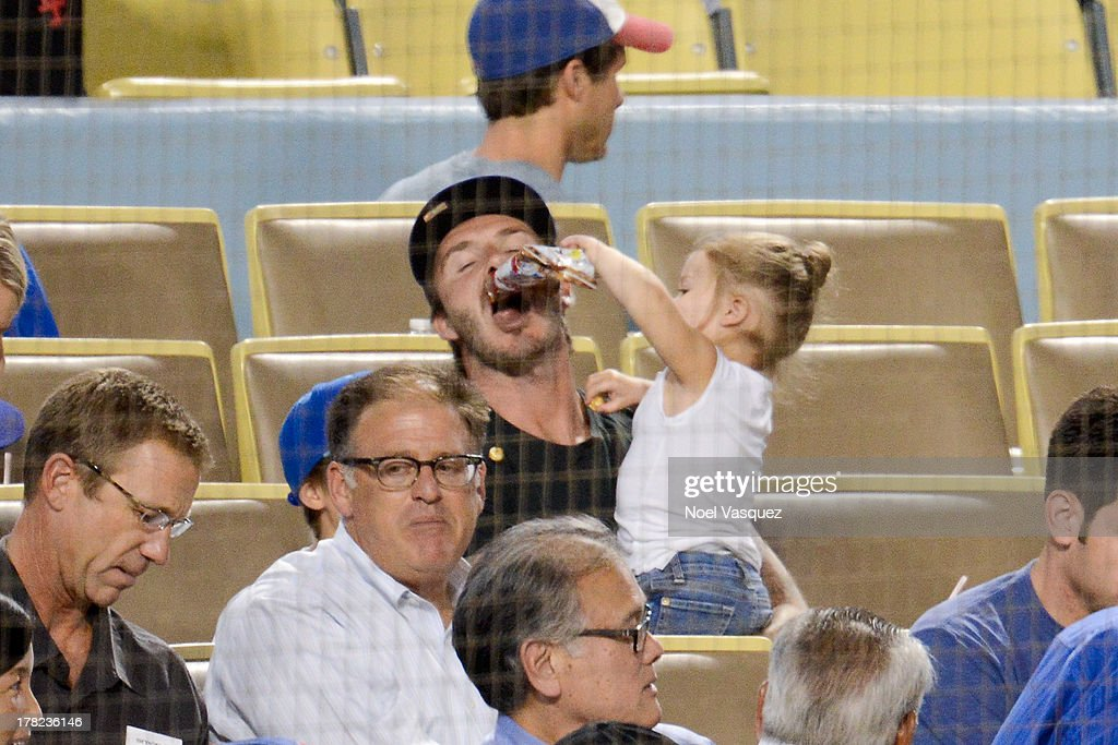 <a gi-track='captionPersonalityLinkClicked' href=/galleries/search?phrase=David+Beckham&family=editorial&specificpeople=158480 ng-click='$event.stopPropagation()'>David Beckham</a> (L) and daughter <a gi-track='captionPersonalityLinkClicked' href=/galleries/search?phrase=Harper+Beckham&family=editorial&specificpeople=8262359 ng-click='$event.stopPropagation()'>Harper Beckham</a> attend a baseball game between the Chicago Cubs and the Los Angeles Dodgers at Dodger Stadium on August 27, 2013 in Los Angeles, California.
