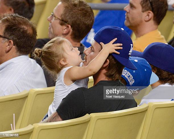 David Beckham and daughter Harper Beckham attend a baseball game between the Chicago Cubs and the Los Angeles Dodgers at Dodger Stadium on August 27...