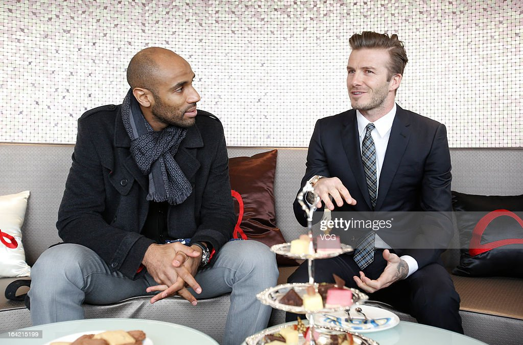 <a gi-track='captionPersonalityLinkClicked' href=/galleries/search?phrase=David+Beckham&family=editorial&specificpeople=158480 ng-click='$event.stopPropagation()'>David Beckham</a> and <a gi-track='captionPersonalityLinkClicked' href=/galleries/search?phrase=Frederic+Kanoute&family=editorial&specificpeople=213590 ng-click='$event.stopPropagation()'>Frederic Kanoute</a> (L) of Beijing Guo'an visit Beijing Guo'an Football Club at Workers Stadium on March 21, 2013 in Beijing, China.