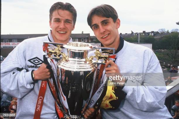 David Beckham and Gary Neville of Manchester United celebrate with the Premiership Trophy during the celebration parade May 12 1996