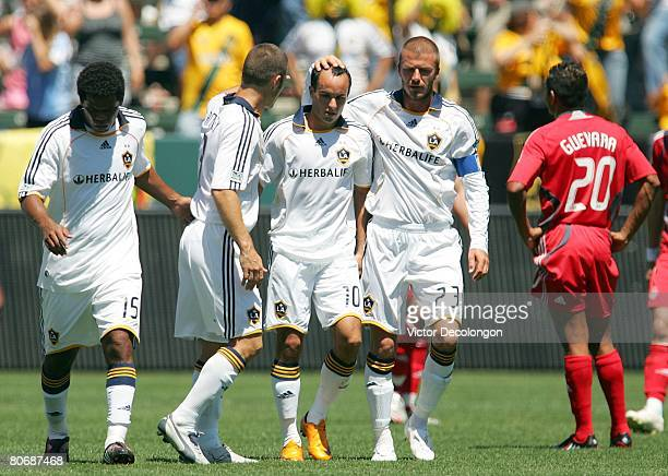David Beckham and Greg Vanney of the Los Angeles Galaxy congratulate Landon Donvoan after Donovan equalized with a goal against Toronto FC in the...