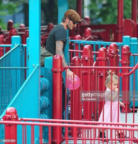 David Beckham and Harper Beckham are seen in Vesuvio Playground in Soho on September 10 2013 in New York City