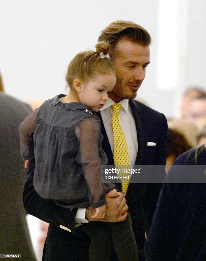 David Beckham and his daughter Harper arrive to watch the presentation of Victoria Beckham's fashions during the Mercedes-Benz Fashion Week Fall/Winter 2014 shows February 9, 2014 in New York City. AFP PHOTO / Don EMMERT
