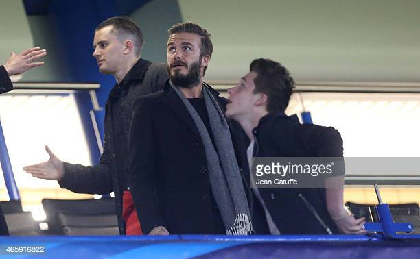 David Beckham and his son Brooklyn Beckham attend the UEFA Champions League match between Chelsea FC and Paris SaintGermain FC at Stamford Bridge...