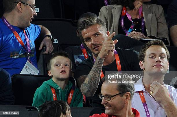 David Beckham and his son Cruz Beckham watch Beach Volleyball on Day 12 of the London 2012 Olympic Games at Horse Guards Parade on August 8 2012 in...