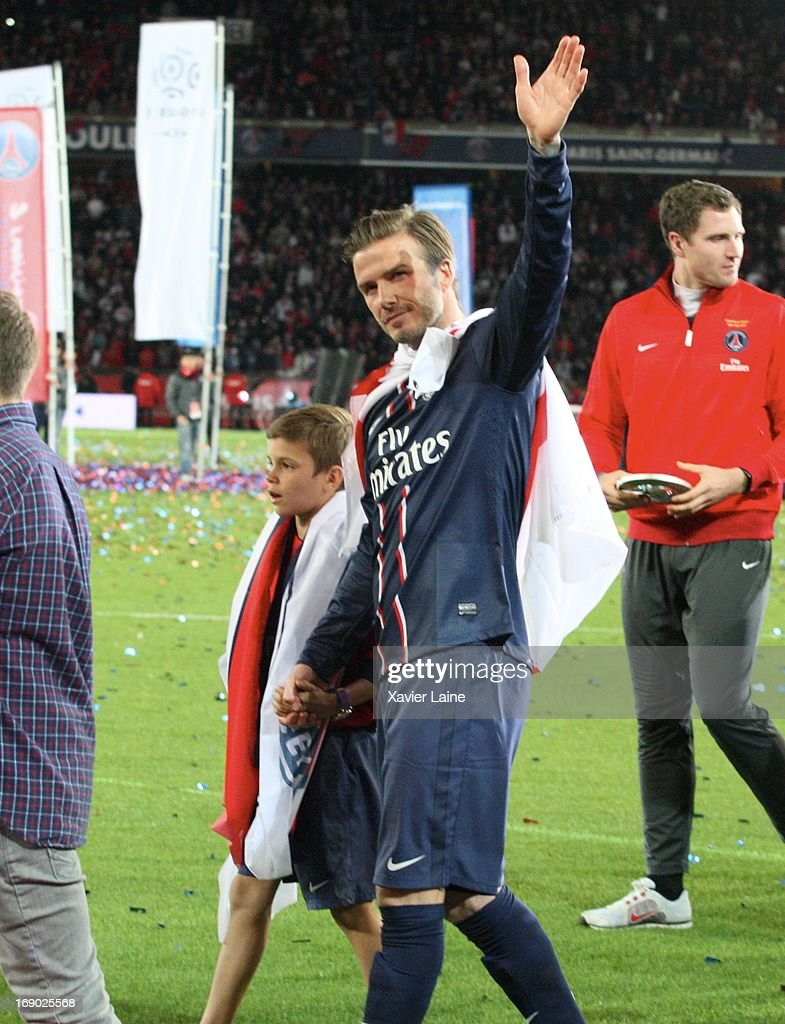 <a gi-track='captionPersonalityLinkClicked' href=/galleries/search?phrase=David+Beckham&family=editorial&specificpeople=158480 ng-click='$event.stopPropagation()'>David Beckham</a> and his son of Paris Saint-Germain celebrate after defeating Stade Brestois 29 at the French League 1 match at Parc des Princes on May 18, 2013 in Paris, France.