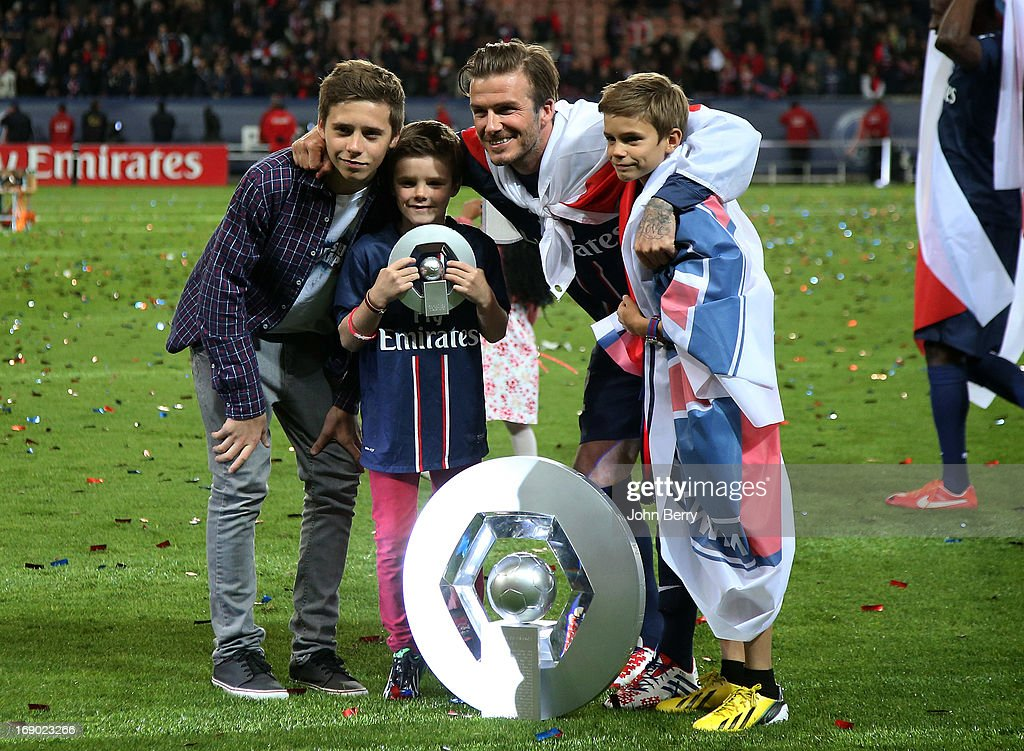 <a gi-track='captionPersonalityLinkClicked' href=/galleries/search?phrase=David+Beckham&family=editorial&specificpeople=158480 ng-click='$event.stopPropagation()'>David Beckham</a> and his sons <a gi-track='captionPersonalityLinkClicked' href=/galleries/search?phrase=Brooklyn+Beckham&family=editorial&specificpeople=214623 ng-click='$event.stopPropagation()'>Brooklyn Beckham</a>, <a gi-track='captionPersonalityLinkClicked' href=/galleries/search?phrase=Cruz+Beckham&family=editorial&specificpeople=4337497 ng-click='$event.stopPropagation()'>Cruz Beckham</a> and <a gi-track='captionPersonalityLinkClicked' href=/galleries/search?phrase=Romeo+Beckham&family=editorial&specificpeople=171832 ng-click='$event.stopPropagation()'>Romeo Beckham</a> pose on the field during the celebration of PSG's french championship title 2013 after the Ligue 1 match between Paris Saint-Germain FC and Stade Brestois 29 at the Parc des Princes stadium on May 18, 2013 in Paris, France.