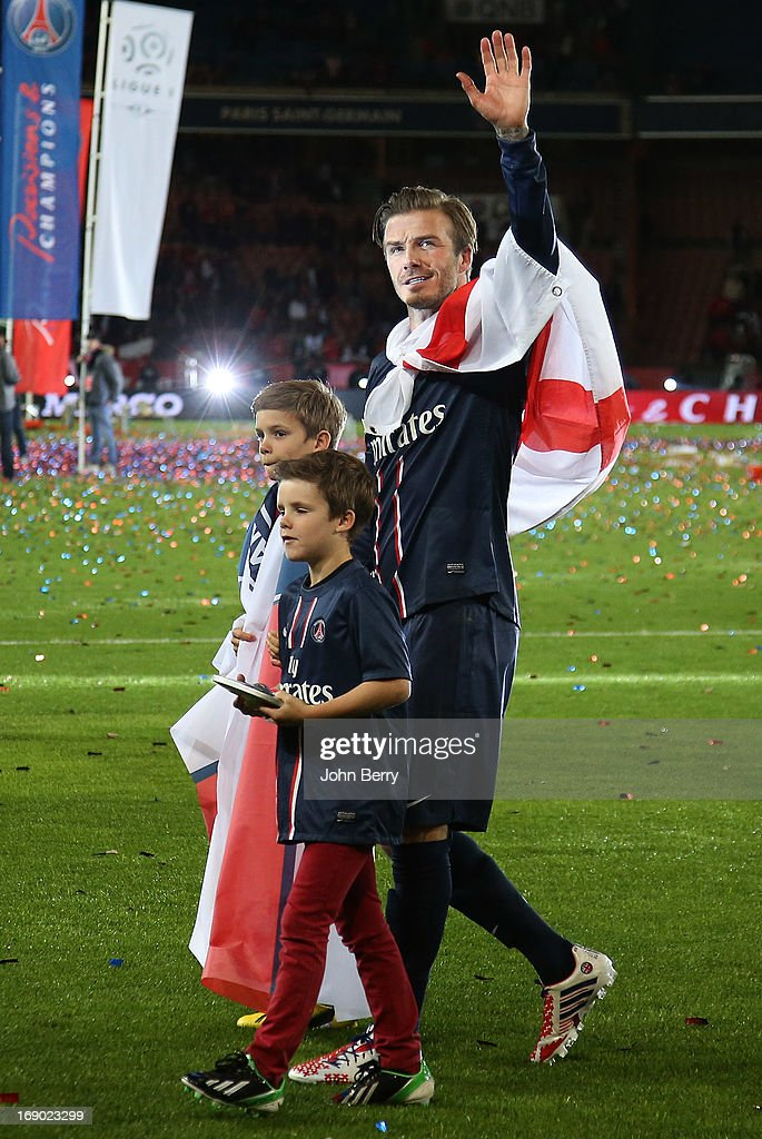 <a gi-track='captionPersonalityLinkClicked' href=/galleries/search?phrase=David+Beckham&family=editorial&specificpeople=158480 ng-click='$event.stopPropagation()'>David Beckham</a> and his sons <a gi-track='captionPersonalityLinkClicked' href=/galleries/search?phrase=Brooklyn+Beckham&family=editorial&specificpeople=214623 ng-click='$event.stopPropagation()'>Brooklyn Beckham</a>, <a gi-track='captionPersonalityLinkClicked' href=/galleries/search?phrase=Cruz+Beckham&family=editorial&specificpeople=4337497 ng-click='$event.stopPropagation()'>Cruz Beckham</a> and <a gi-track='captionPersonalityLinkClicked' href=/galleries/search?phrase=Romeo+Beckham&family=editorial&specificpeople=171832 ng-click='$event.stopPropagation()'>Romeo Beckham</a> walk on the field during the celebration of PSG's french championship title 2013 after the Ligue 1 match between Paris Saint-Germain FC and Stade Brestois 29 at the Parc des Princes stadium on May 18, 2013 in Paris, France.