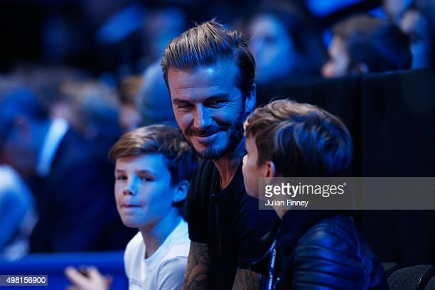 David Beckham and his sons Cruz and Romeo attend the men's singles semi final between Rafael Nadal of Spain and Novak Djokovic of Serbia on day seven...