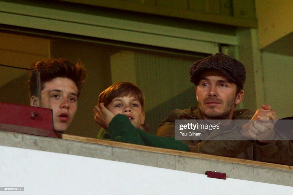 <a gi-track='captionPersonalityLinkClicked' href=/galleries/search?phrase=David+Beckham&family=editorial&specificpeople=158480 ng-click='$event.stopPropagation()'>David Beckham</a> and his sons <a gi-track='captionPersonalityLinkClicked' href=/galleries/search?phrase=Romeo+Beckham&family=editorial&specificpeople=171832 ng-click='$event.stopPropagation()'>Romeo Beckham</a> and <a gi-track='captionPersonalityLinkClicked' href=/galleries/search?phrase=Brooklyn+Beckham&family=editorial&specificpeople=214623 ng-click='$event.stopPropagation()'>Brooklyn Beckham</a> watch the action during the Barclays Premier League match between West Ham United and Manchester United at Boleyn Ground on March 22, 2014 in London, England.