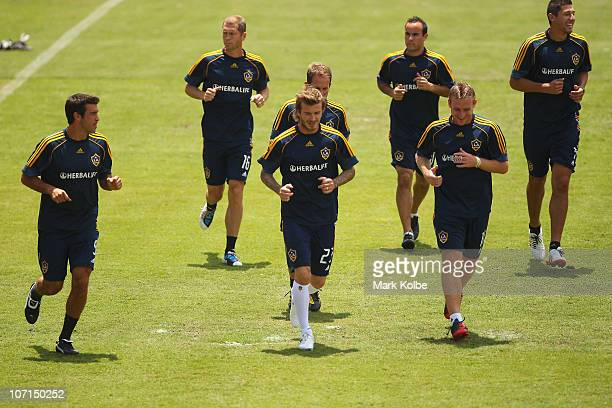 David Beckham and his team mates warmup during an LA Galaxy training session at EnergyAustralia Stadium on November 26 2010 in Newcastle Australia