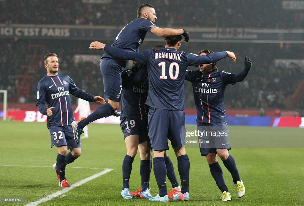 <a gi-track='captionPersonalityLinkClicked' href=/galleries/search?phrase=David+Beckham&family=editorial&specificpeople=158480 ng-click='$event.stopPropagation()'>David Beckham</a> and Jeremy Menez of Paris Saint-Germain celebrate a goal during the French League 1 between Paris Saint-Germain FC and Montpellier Herault SC, at Parc des Princes on March 29, 2013 in Paris, France.