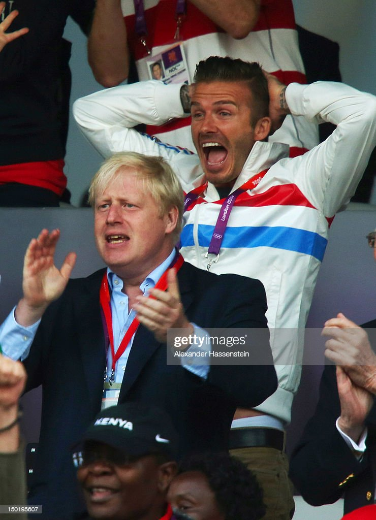 David Beckham and Mayor of London Boris Johnson celebrate as Mohamed Farah of Great Britain wins gold in the Men's 5000m Final on Day 15 of the London 2012 Olympic Games at Olympic Stadium on August 11, 2012 in London, England.