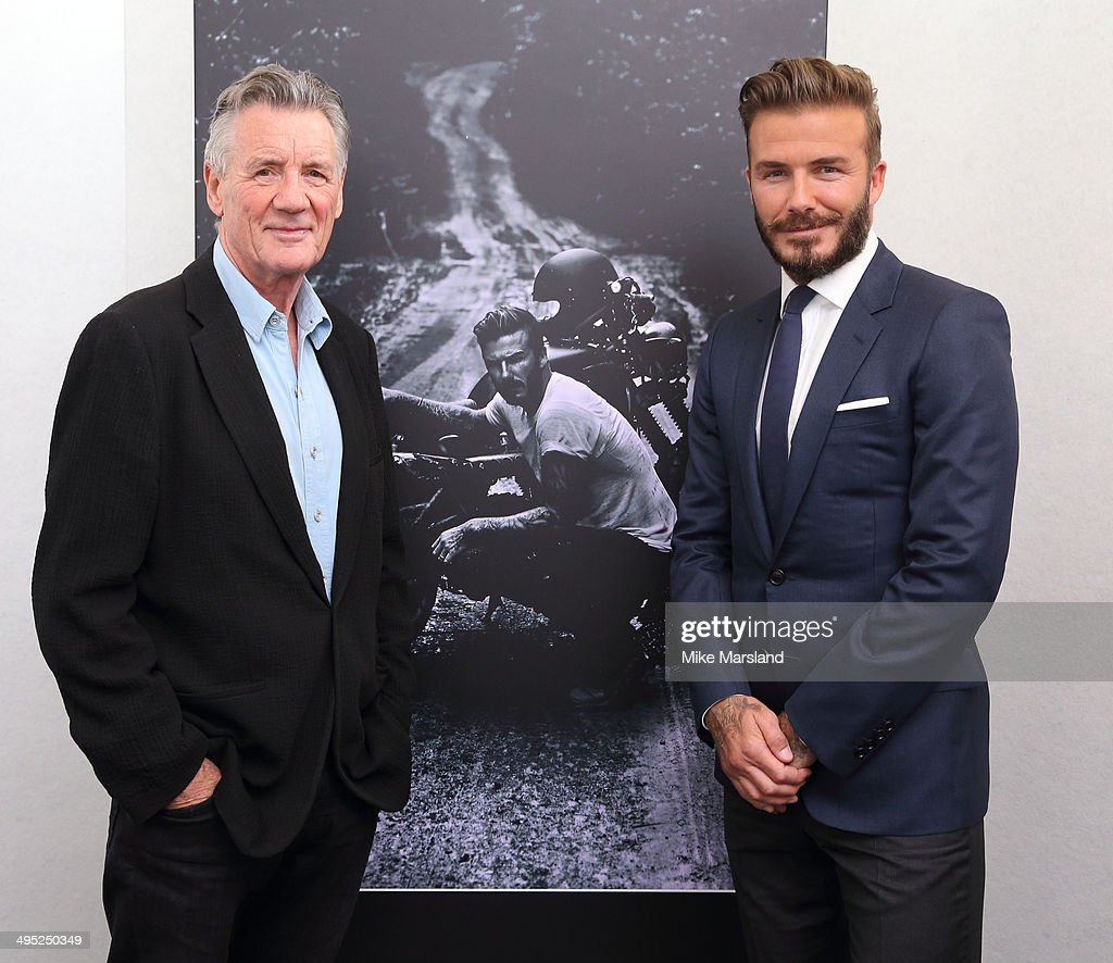 David Beckham and Michael Palin attend a photocall to launch 'David Beckham: Into The Unknown' at The Serpentine Sackler Gallery on June 2, 2014 in London, England.