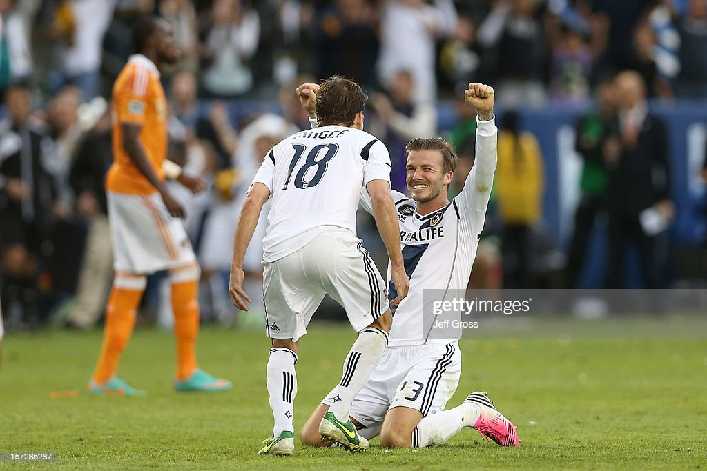 David Beckham and Mike Magee of Los Angeles Galaxy celebrate in the second half against the Houston Dynamo in the 2012 MLS Cup at The Home Depot...