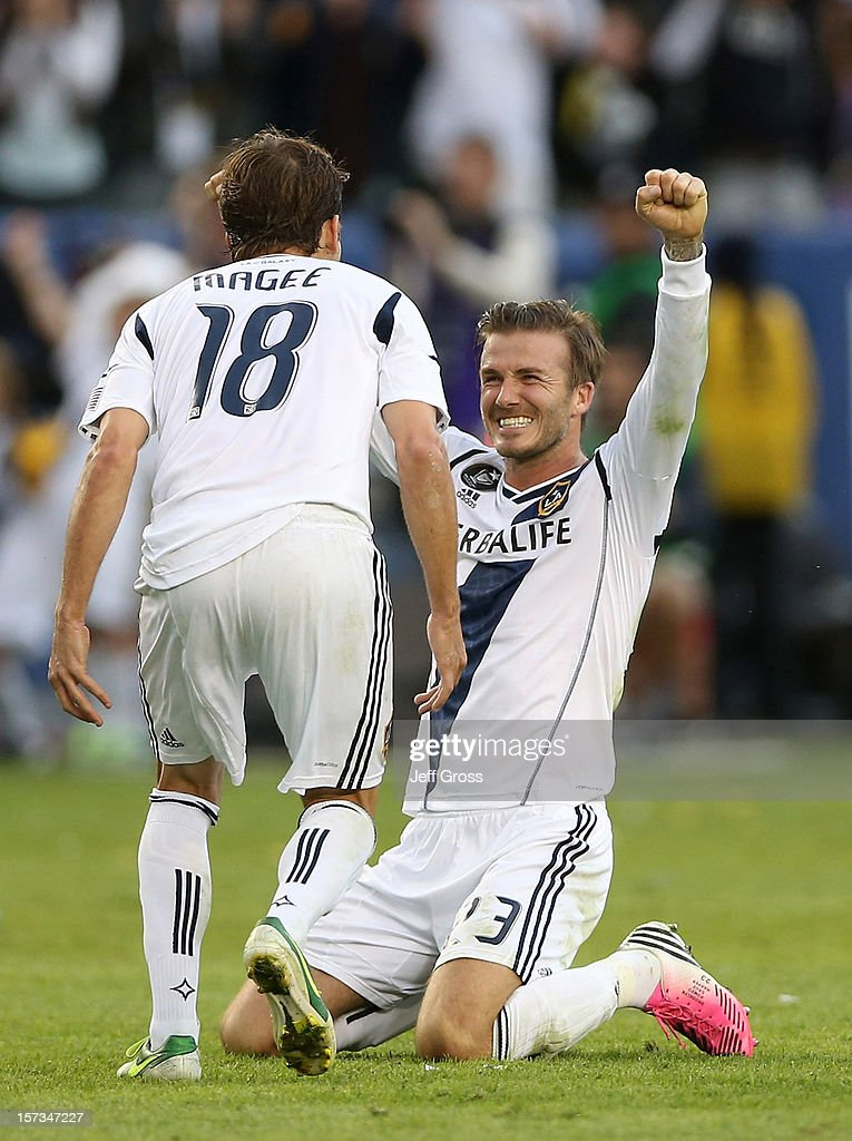 David Beckham #23 and Mike Magee #18 of Los Angeles Galaxy celebrate in the second half against the Houston Dynamo in the 2012 MLS Cup at The Home Depot Center on December 1, 2012 in Carson, California.
