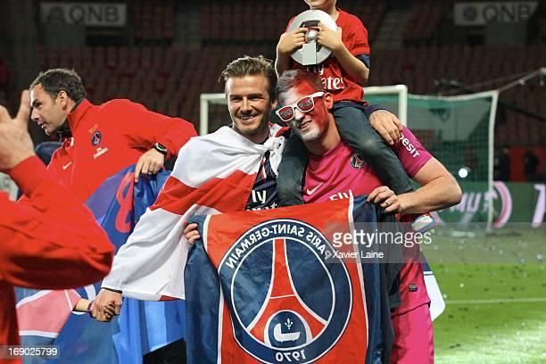 David Beckham and Nicolas Douchez of Paris SaintGermain celebrates after defeating Stade Brestois 29 at the French League 1 match at Parc des Princes...