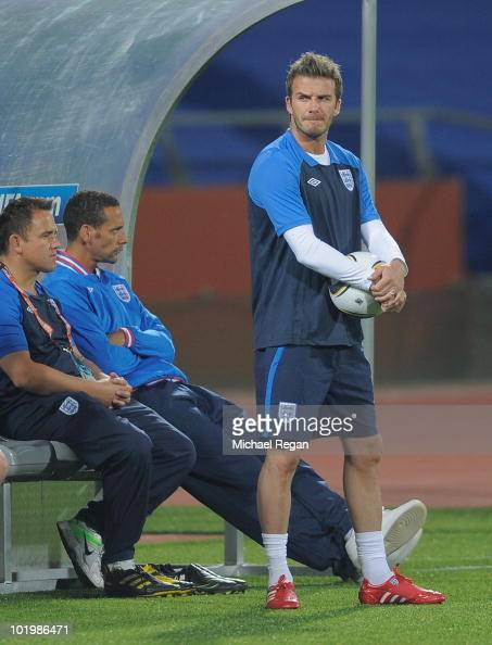David Beckham and Rio Ferdinand look on from the bench during the England training session at the Royal Bafokeng Stadium on June 11 2010 in...