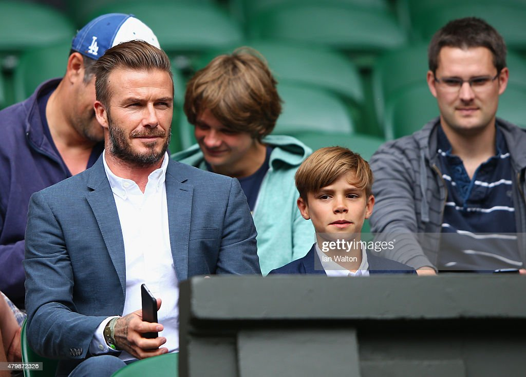 David Beckham and son Romeo Beckham attend day nine of the Wimbledon Lawn Tennis Championships at the All England Lawn Tennis and Croquet Club on...