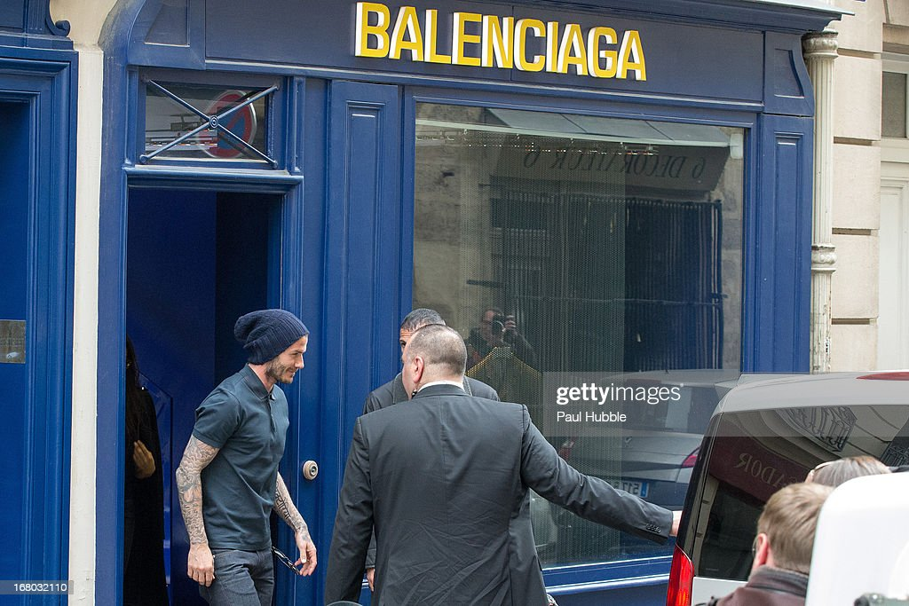 <a gi-track='captionPersonalityLinkClicked' href=/galleries/search?phrase=David+Beckham&family=editorial&specificpeople=158480 ng-click='$event.stopPropagation()'>David Beckham</a> and Victoria beckham are seen leaving the 'BALENCIAGA' store on May 4, 2013 in Paris, France.