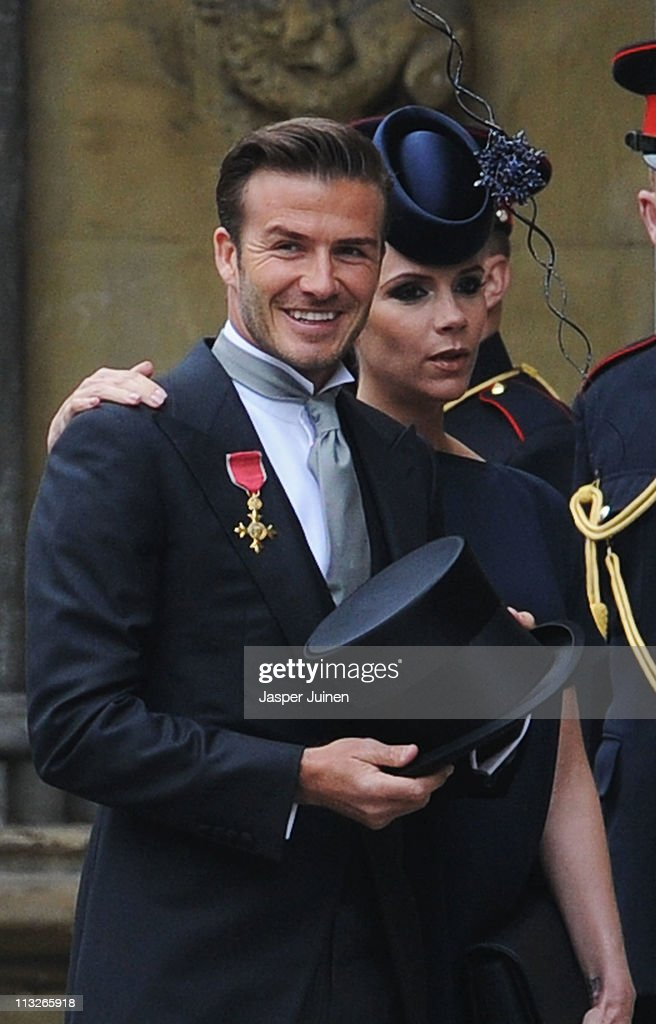 <a gi-track='captionPersonalityLinkClicked' href=/galleries/search?phrase=David+Beckham&family=editorial&specificpeople=158480 ng-click='$event.stopPropagation()'>David Beckham</a> and <a gi-track='captionPersonalityLinkClicked' href=/galleries/search?phrase=Victoria+Beckham&family=editorial&specificpeople=161100 ng-click='$event.stopPropagation()'>Victoria Beckham</a> arrive to attend the Royal Wedding of Prince William to Catherine Middleton at Westminster Abbey on April 29, 2011 in London, England. The marriage of the second in line to the British throne is to be led by the Archbishop of Canterbury and will be attended by 1900 guests, including foreign Royal family members and heads of state. Thousands of well-wishers from around the world have also flocked to London to witness the spectacle and pageantry of the Royal Wedding.
