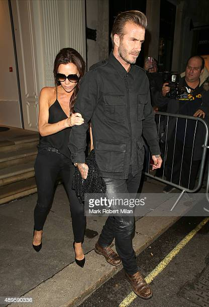 David Beckham and Victoria Beckham at the Victoria Beckham store on Dover Street on September 22 2015 in London England
