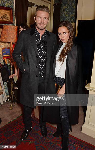 David Beckham and Victoria Beckham attend a party hosted by David Beckham and Alister Mackie to celebrate Another Man Magazine at Mark's Club on...