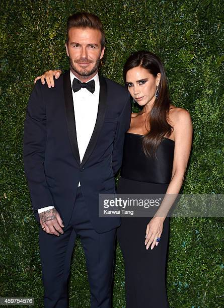 David Beckham and Victoria Beckham attend the 60th London Evening Standard Theatre Awards at London Palladium on November 30 2014 in London England