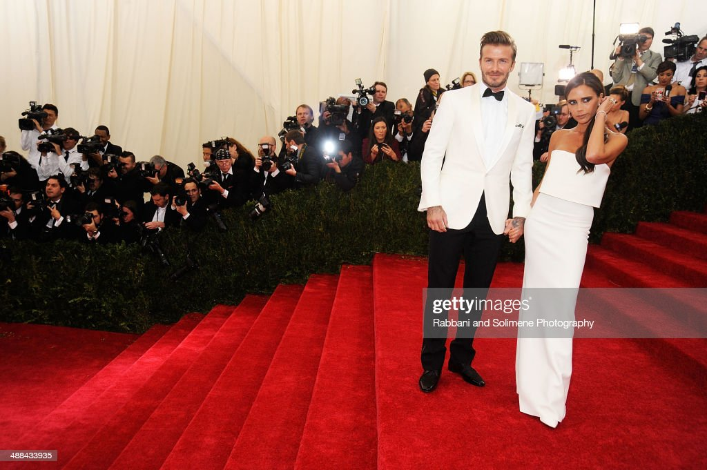 David Beckham and Victoria Beckham attends the 'Charles James: Beyond Fashion' Costume Institute Gala at the Metropolitan Museum of Art on May 5, 2014 in New York City.