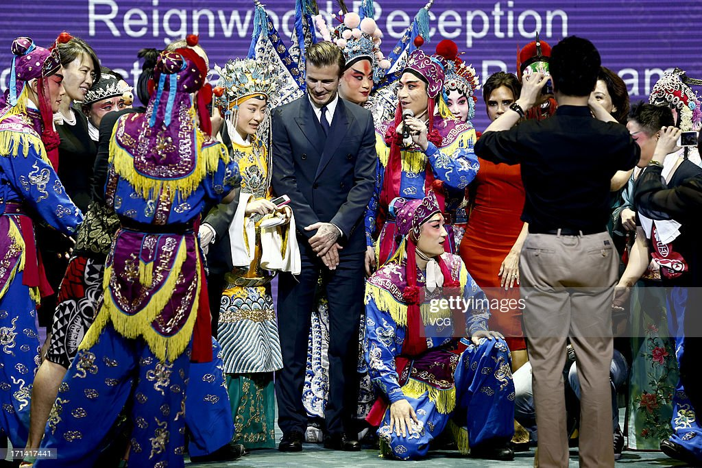 <a gi-track='captionPersonalityLinkClicked' href=/galleries/search?phrase=David+Beckham&family=editorial&specificpeople=158480 ng-click='$event.stopPropagation()'>David Beckham</a> and <a gi-track='captionPersonalityLinkClicked' href=/galleries/search?phrase=Victoria+Beckham&family=editorial&specificpeople=161100 ng-click='$event.stopPropagation()'>Victoria Beckham</a> pose with Peking Opera performers during a reception at Reignwood Center on June 23, 2013 in Beijing, China.