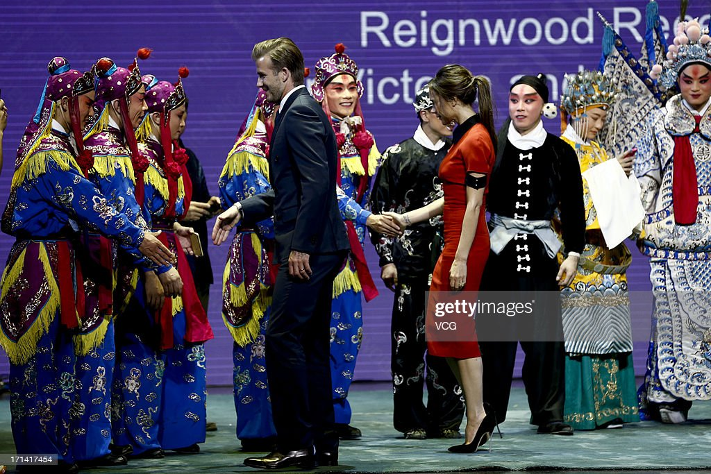 <a gi-track='captionPersonalityLinkClicked' href=/galleries/search?phrase=David+Beckham&family=editorial&specificpeople=158480 ng-click='$event.stopPropagation()'>David Beckham</a> and <a gi-track='captionPersonalityLinkClicked' href=/galleries/search?phrase=Victoria+Beckham&family=editorial&specificpeople=161100 ng-click='$event.stopPropagation()'>Victoria Beckham</a> shake hands with Peking Opera performers during a reception at Reignwood Center on June 23, 2013 in Beijing, China.